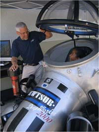 Dr. Guggenheim's student tries a submersible on for size